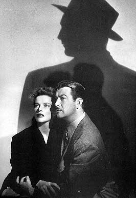 "Heburn and Taylor in the shadow of Mitchum in ""Undercurrent."""