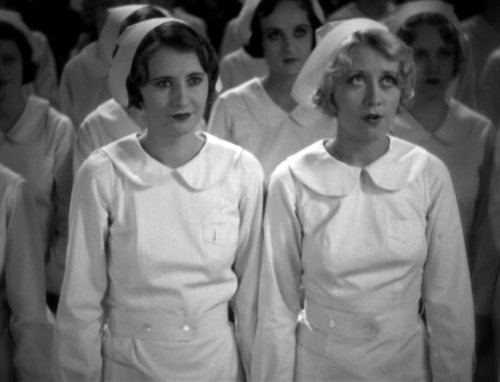 Lora is all aglow as she takes the nurse's pledge. Maloney . . . not so much.