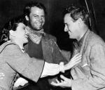 "William Wellman on the set of ""The Great Man's Lady"" with Stanwyck and Joel McCrea."