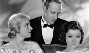 Ann Harding and Myrna Loy vie for the heart of Leslie Howard.