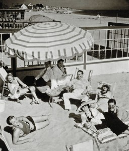 A gathering of pals at the Malibu beach house (from bottom left): Douglas Fairbanks, Lilyan, Clifton Webb, Kenneth McKenna, Kay Francis, Ivor Novello, and Joan Crawford
