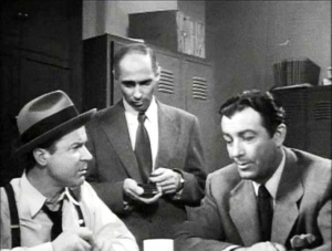 Sid Myers (center) -- the cop in the thirty-buck suit.