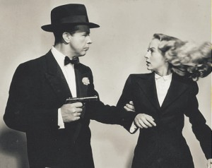 Keyes and Powell strike a dramatic pose in a promotional still for Johnny O'Clock.