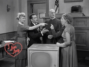 Olsen tries mightily to referee the battling buddies on I Love Lucy.