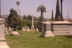 The tall obelisk in the center is Griffith's tombstone; and in the distance you can see the Griffith Observatory.
