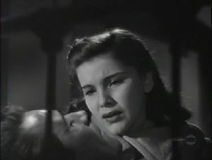 Teena (Debra Paget) sneaks into the hospital for this touching scene.