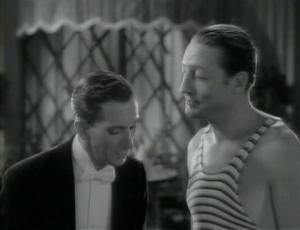 Warren William gives instructions to his butler during the pool party.