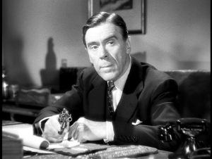 Leo G. Carroll. A Hitchcock staple.
