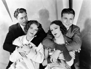 The primary cast members, played by Warner Baxter, Ruby Keeler, Bebe Daniels, and Dick Powell,